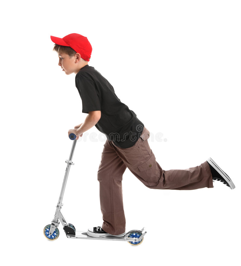 Bambino che guida un giocattolo del motorino immagine stock