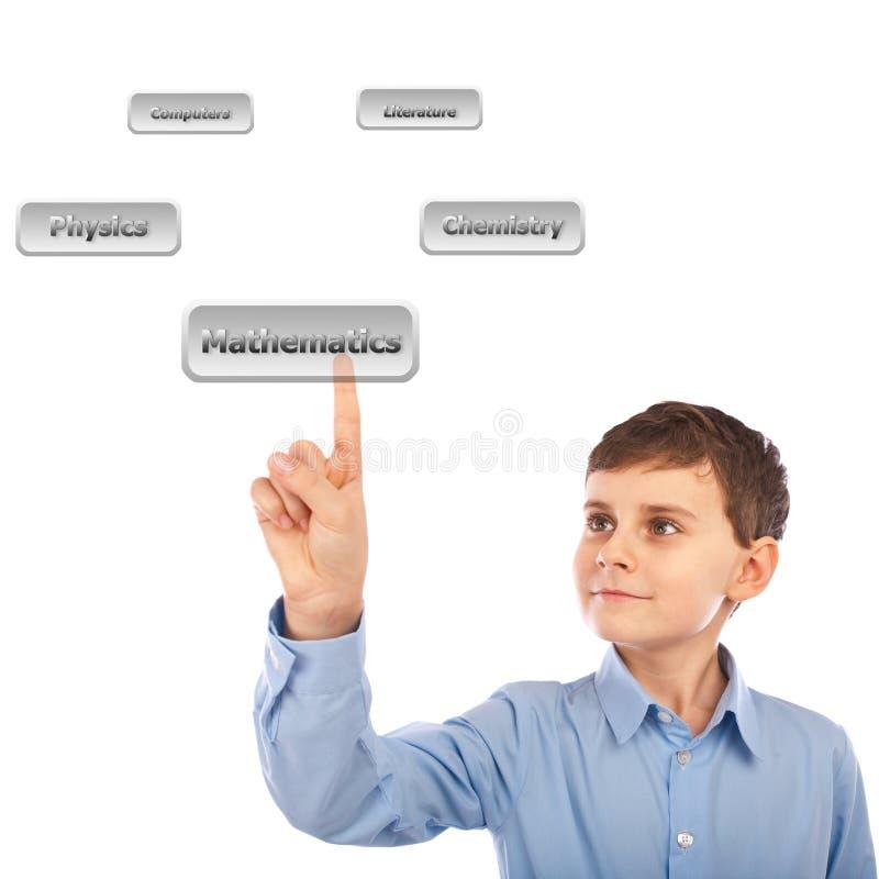 Bambino che sceglie i suoi corsi con i tasti virtuali fotografia stock