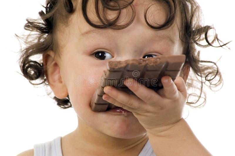 Bambino con cioccolato. fotografia stock
