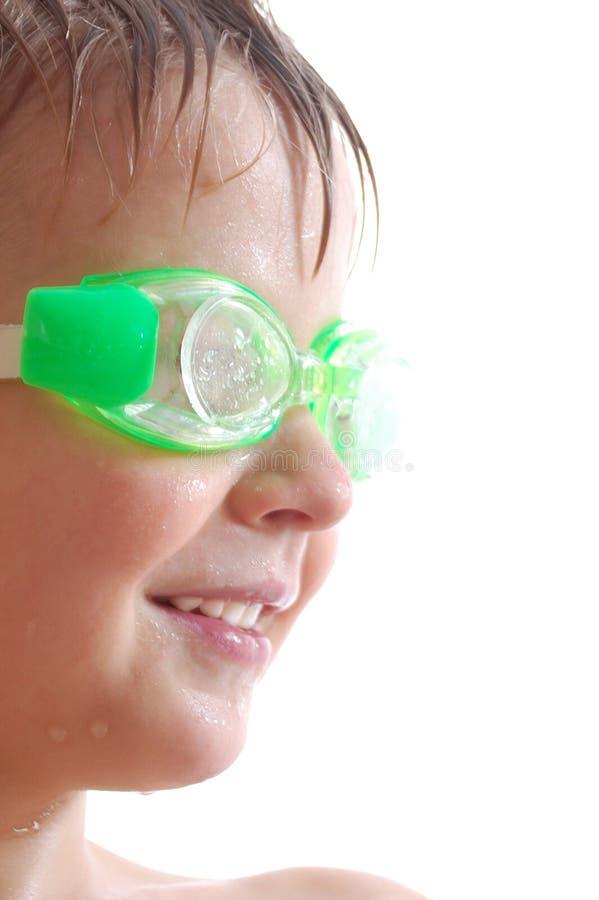 Bambino con gli occhiali di protezione fotografia stock