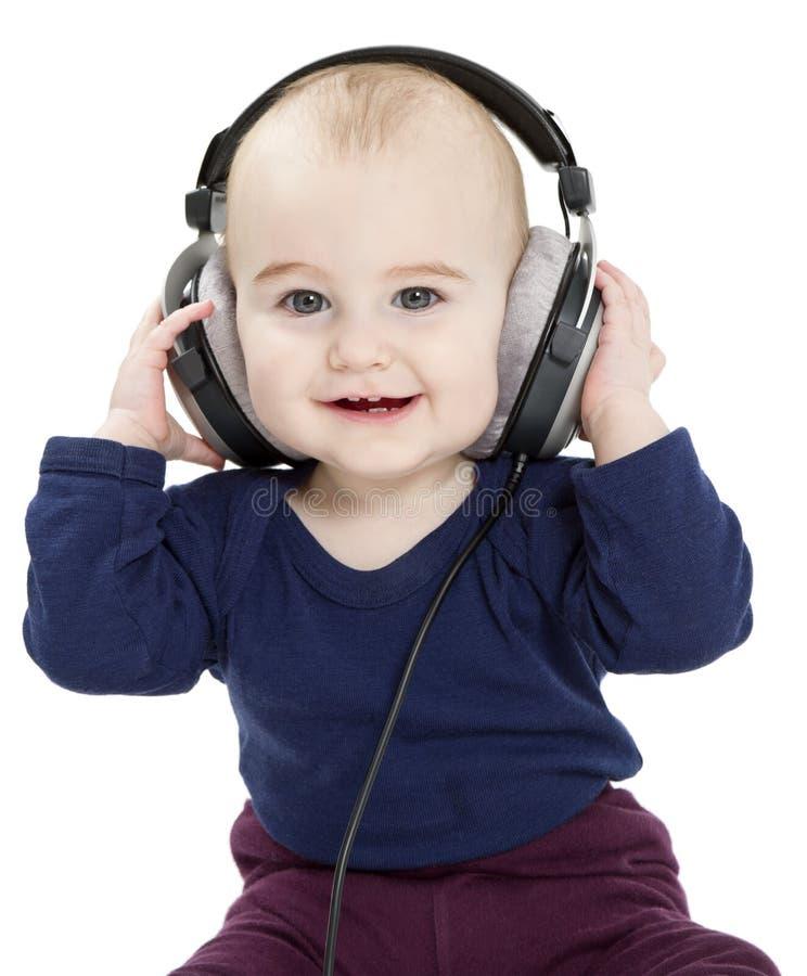 Bambino con i trasduttori auricolari fotografia stock libera da diritti