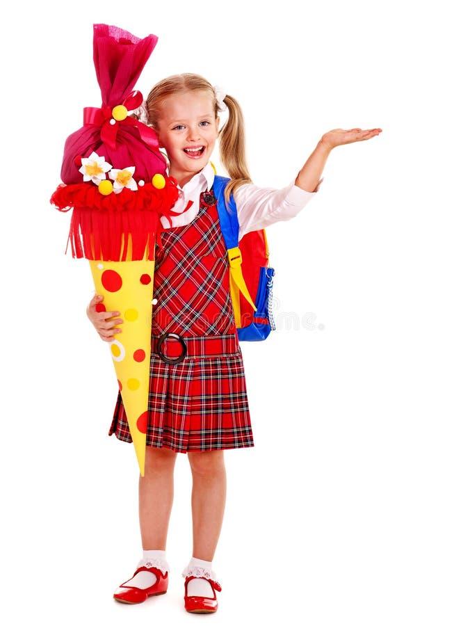 Bambino con il cono della scuola. fotografia stock