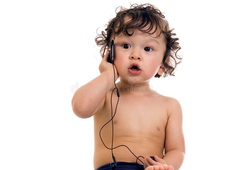Bambino con il giocatore MP3. fotografia stock