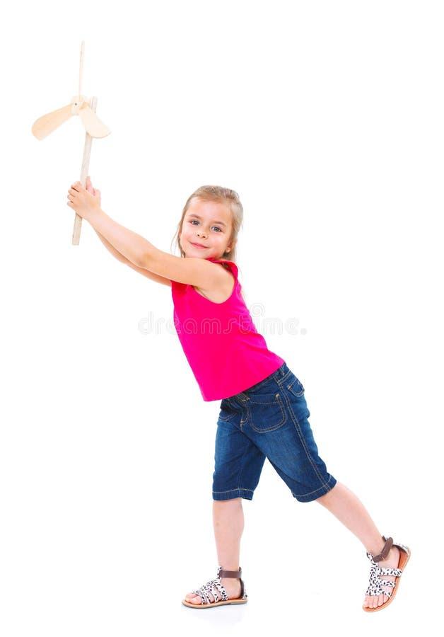 Bambino con il giocattolo del mulino a vento immagine stock