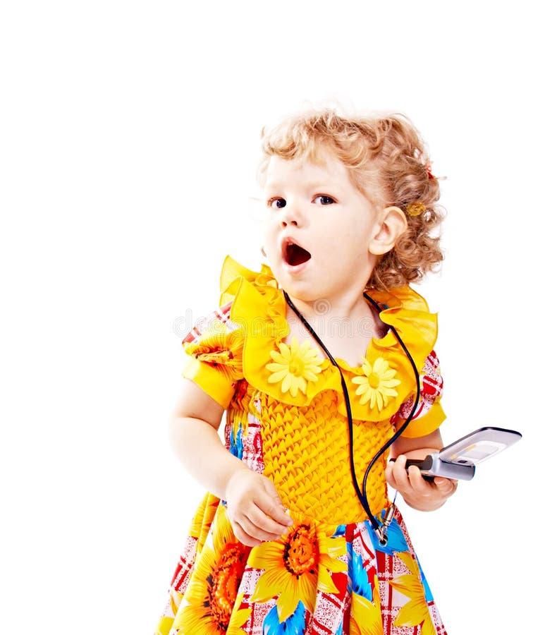 Bambino con il telefono mobile fotografie stock libere da diritti
