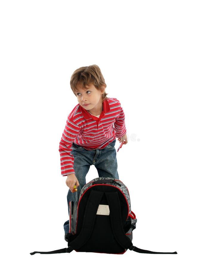 Bambino con il vostro sacchetto immagine stock