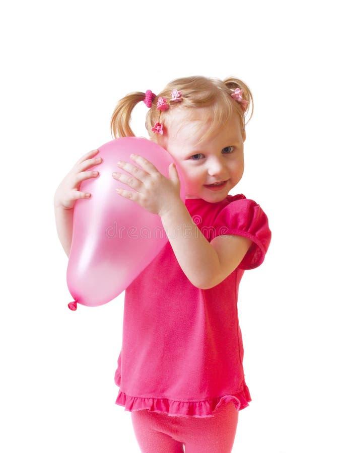 Bambino con l'aerostato isolato su bianco fotografia stock