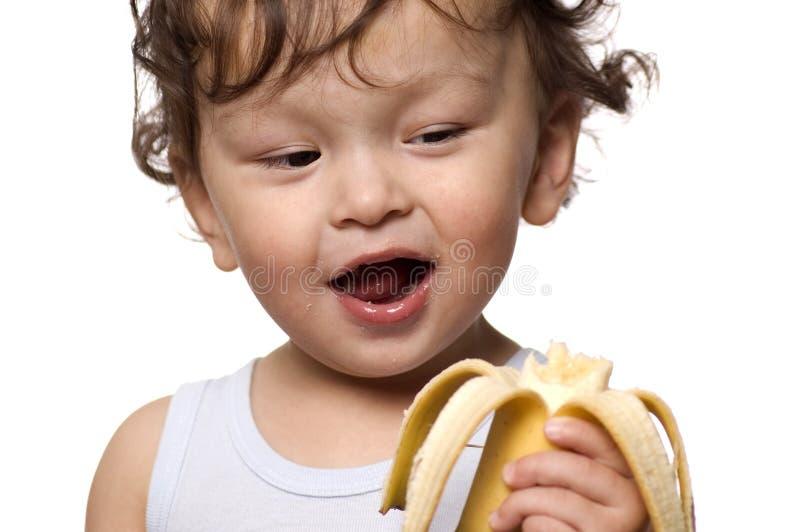 Bambino con la banana. immagine stock libera da diritti