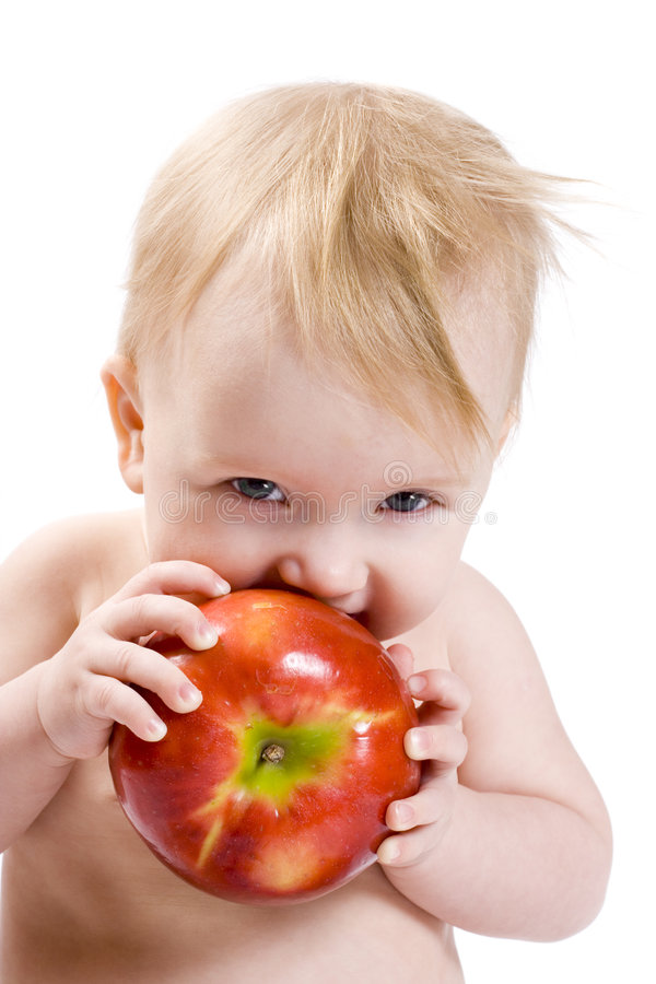 Bambino con la mela fotografia stock libera da diritti