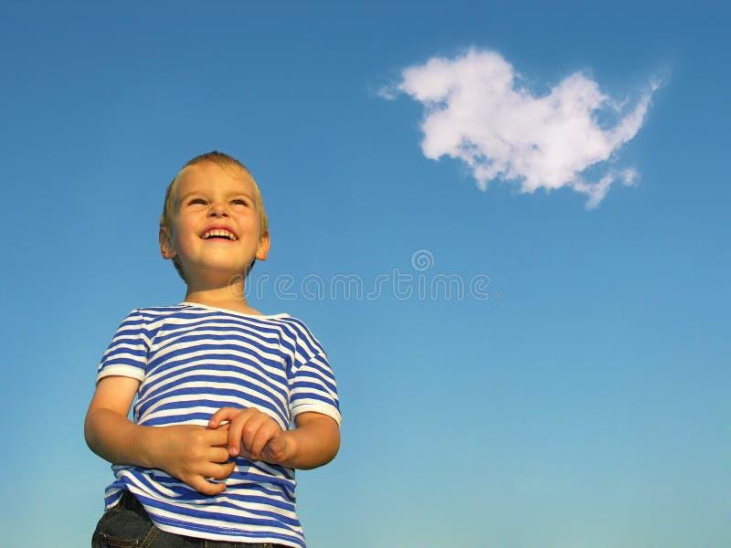Bambino con la nube fotografia stock libera da diritti