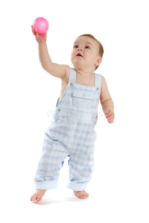 Bambino con la sfera fotografia stock