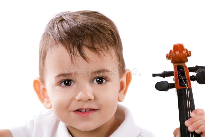 Bambino con lo strumento di musica fotografie stock libere da diritti