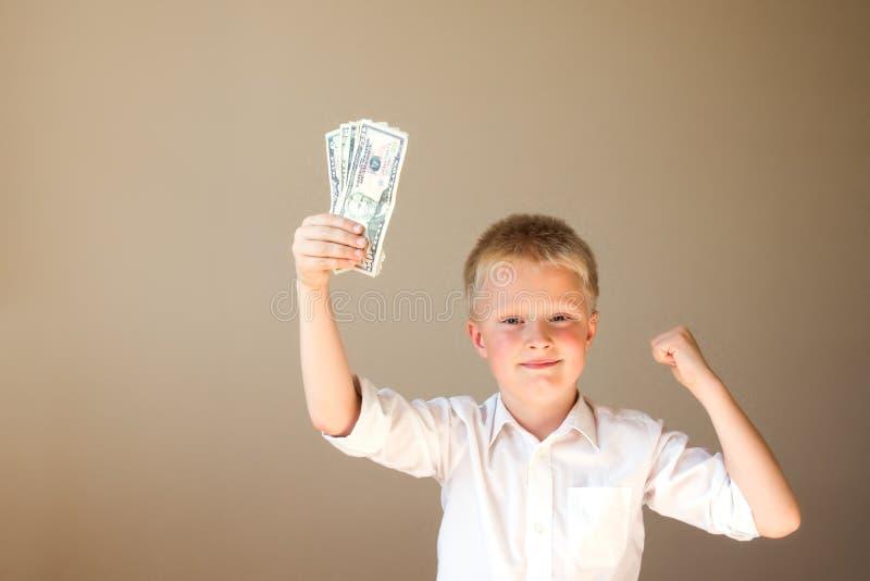 Bambino con soldi (dollari) fotografia stock