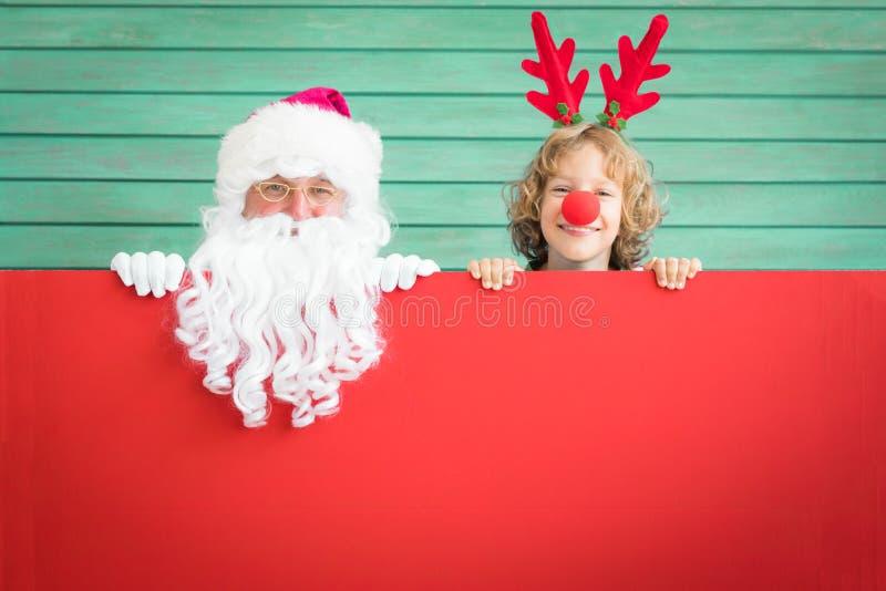 Bambino della renna e di Santa Claus immagine stock