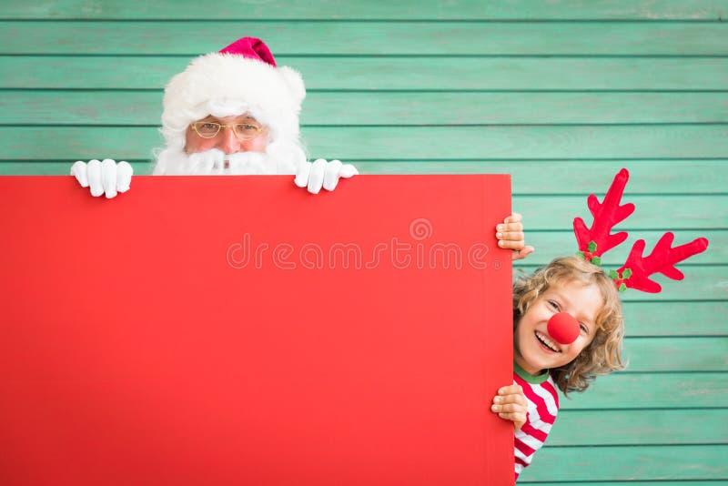 Bambino della renna e di Santa Claus fotografia stock