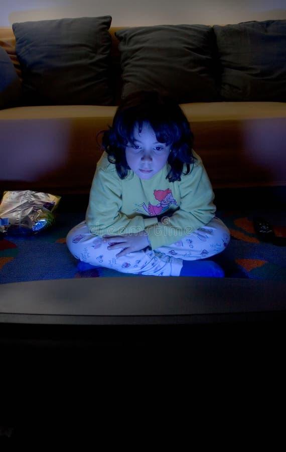 Bambino dello schiavo della TV immagini stock libere da diritti