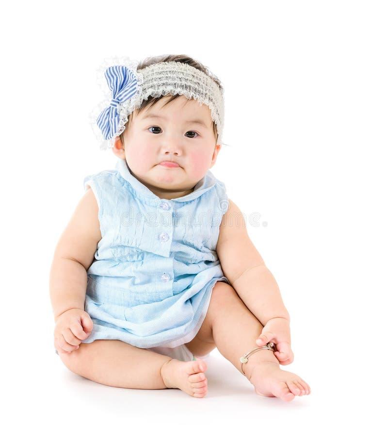 Bambino di Asain che ritiene triste immagine stock