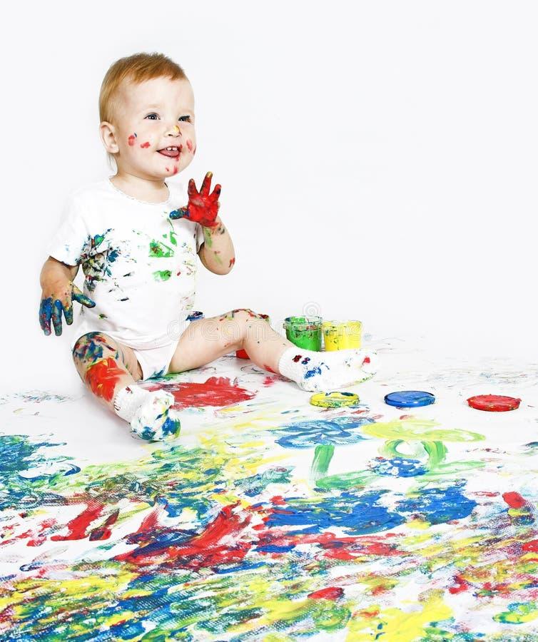 Bambino di bellezza con vernice su bianco immagini stock libere da diritti