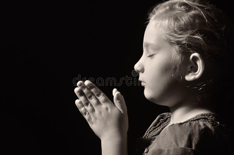 Bambino di preghiera. fotografia stock