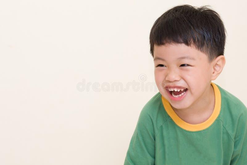 Bambino di risata immagine stock
