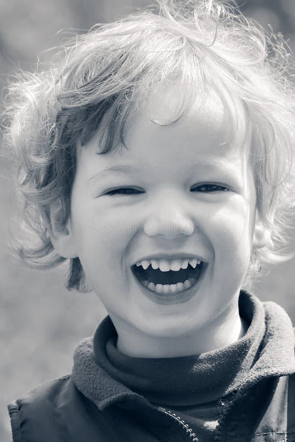 Bambino di risata felice fotografia stock