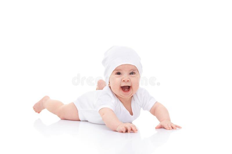 Bambino di risata sveglio su fondo bianco fotografia stock libera da diritti