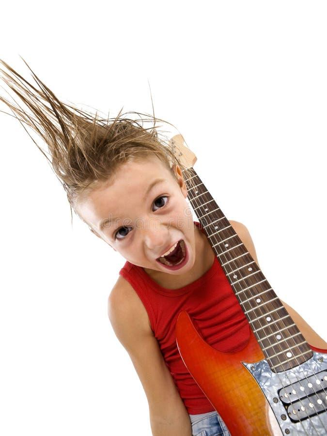 Bambino di Rockstar con la chitarra immagine stock