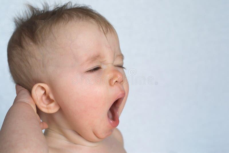 Bambino di sbadiglio fotografia stock