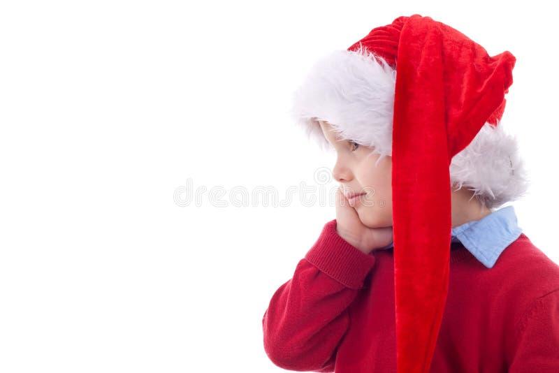 Bambino divertente con il cappello della Santa fotografia stock libera da diritti