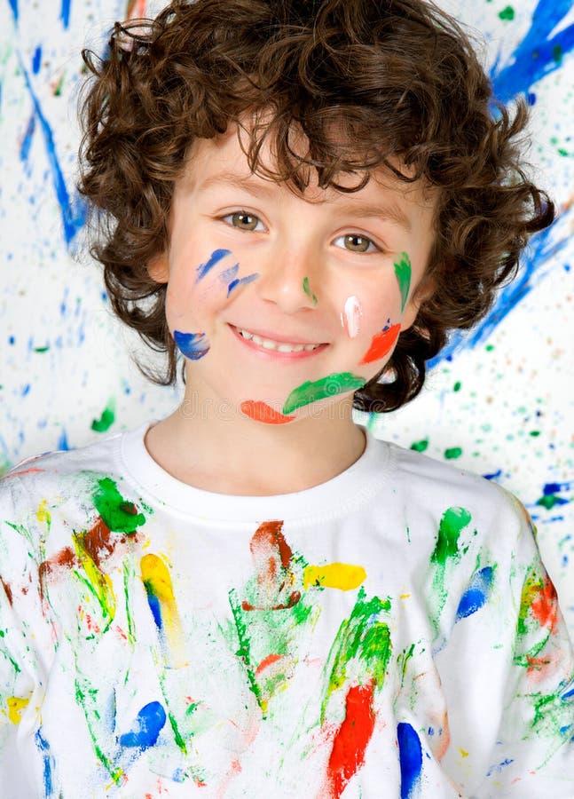 Bambino divertente con il fronte dipinto immagine stock libera da diritti