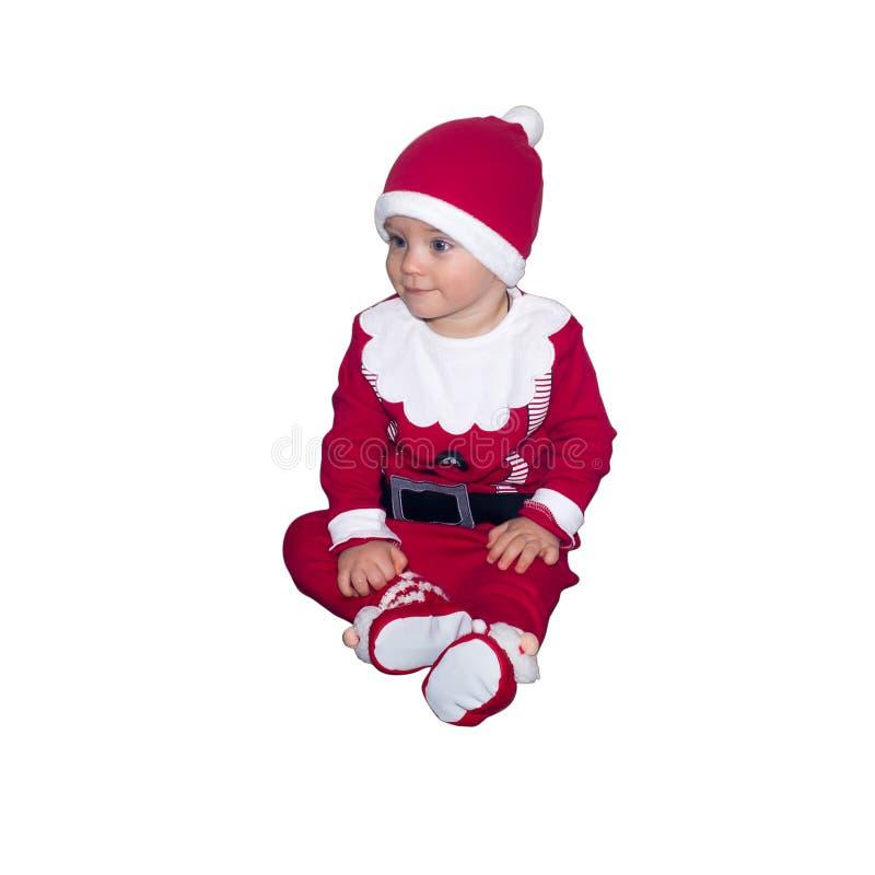 Bambino divertente in vestiti di Santa Claus isolati immagine stock