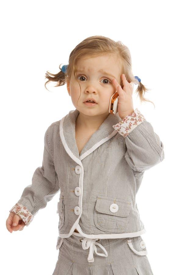 Bambino e cellulare fotografie stock