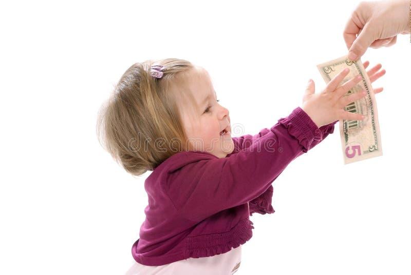 Bambino e cinque dollari fotografie stock