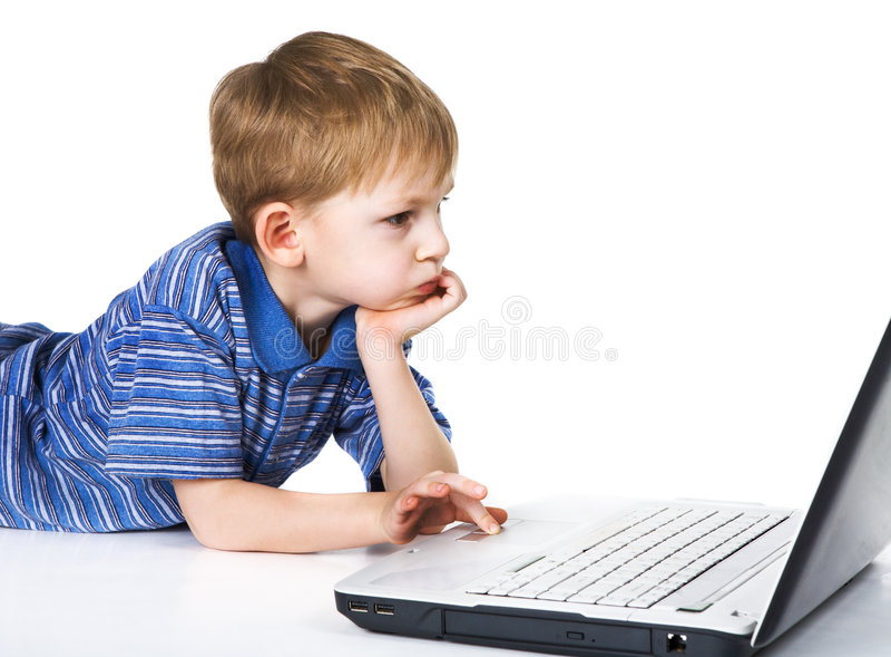 Bambino e computer portatile immagini stock libere da diritti