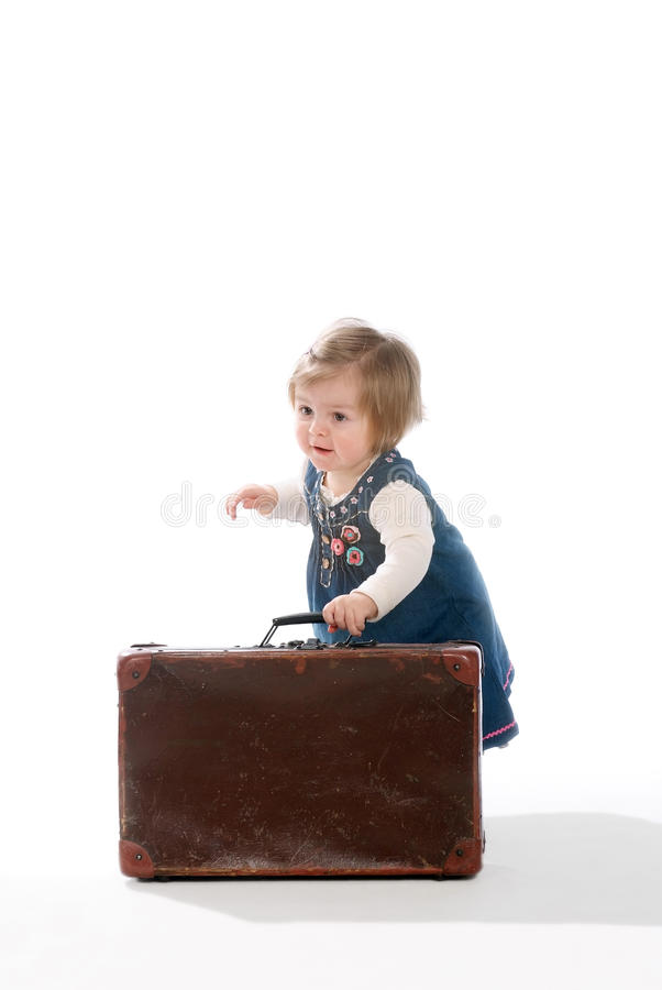 Bambino e valigia fotografia stock libera da diritti