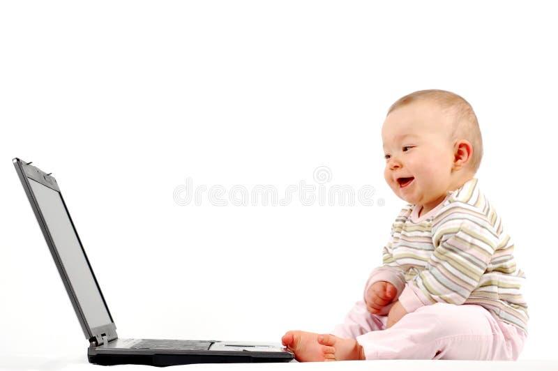 Bambino felice con il computer portatile #13 immagine stock libera da diritti