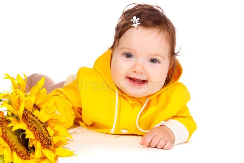 Bambino felice del fiore fotografia stock libera da diritti