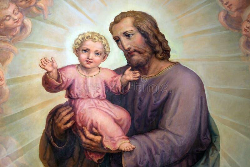 Bambino Gesù, pala della tenuta di Saint Joseph nella basilica del cuore sacro di Gesù a Zagabria immagine stock libera da diritti
