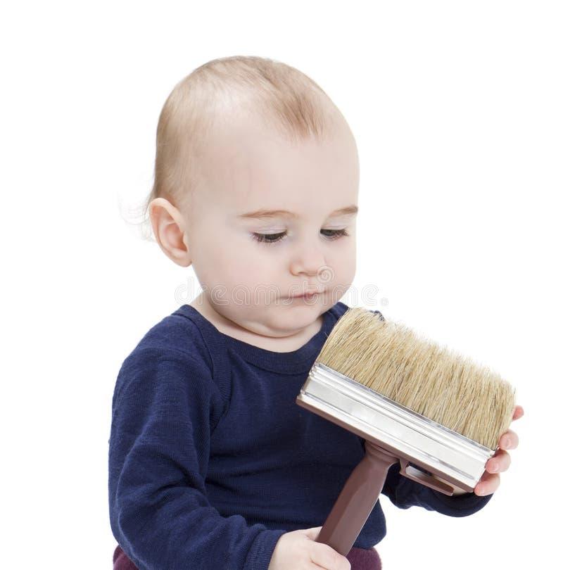 Bambino in giovane età con la spazzola fotografia stock
