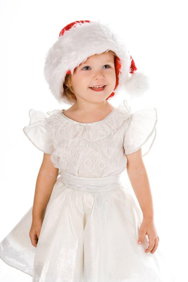 Bambino grazioso in cappello di colore rosso della Santa immagine stock