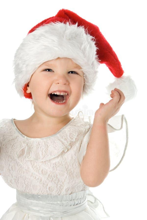 Bambino grazioso in cappello di colore rosso della Santa fotografia stock libera da diritti