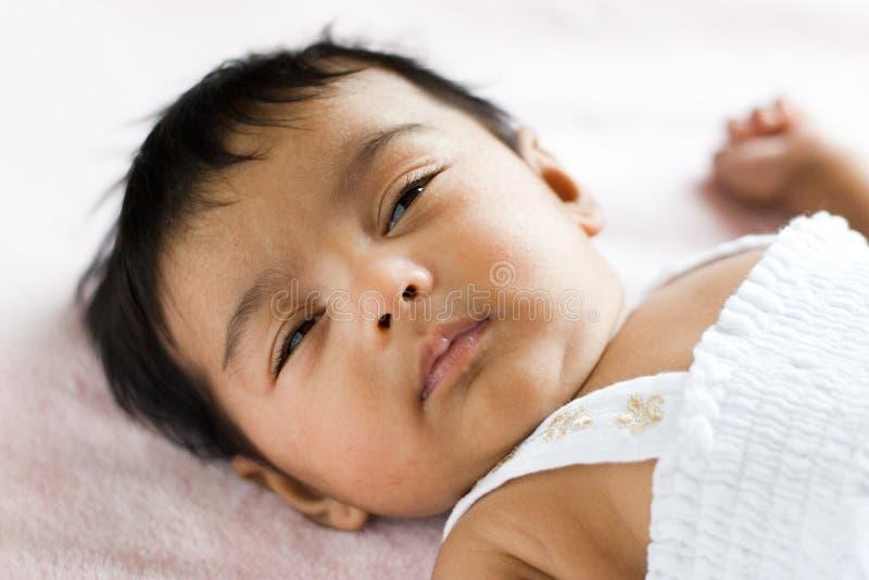 Bambino indiano sonnolento immagine stock