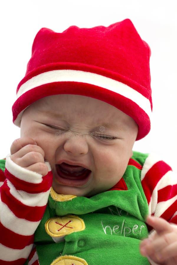 Bambino infelice di natale fotografia stock
