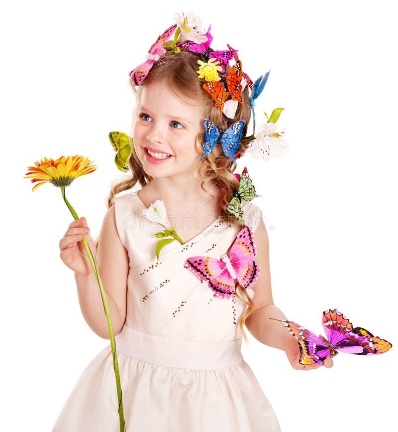 Bambino in l'acconciatura e la farfalla di primavera. fotografia stock