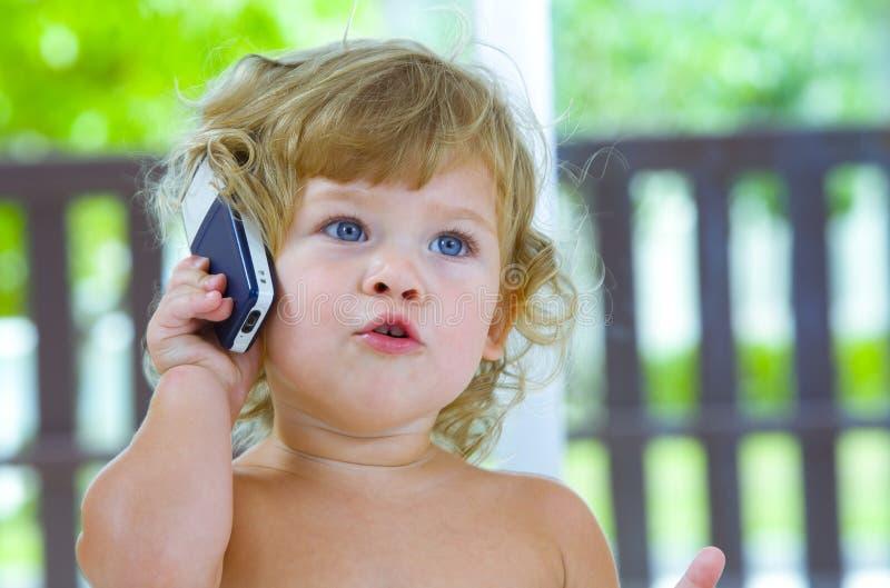 Bambino mobile immagine stock libera da diritti