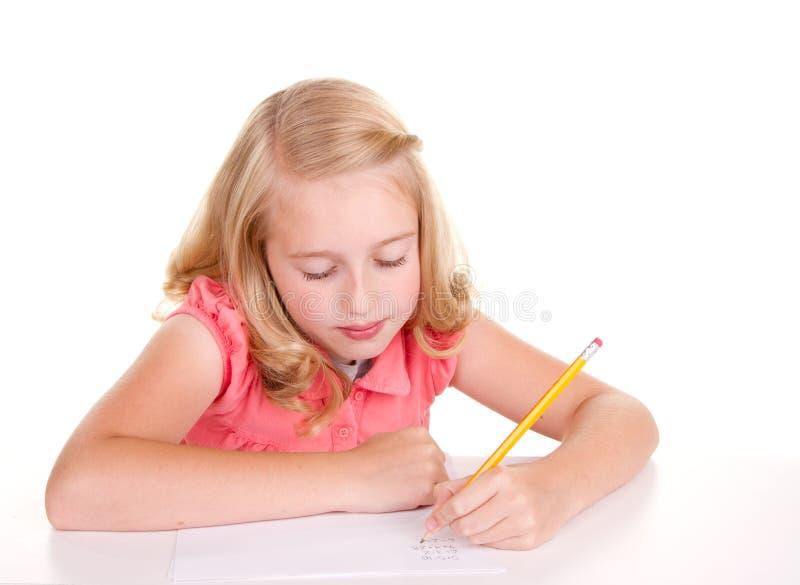 Bambino o adolescente più anziano che fa per la matematica immagine stock