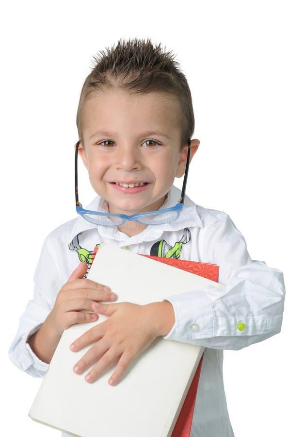 Bambino sorridente il loro primo giorno della scuola immagini stock libere da diritti