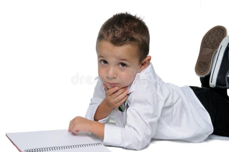 Bambino sorridente il loro primo giorno della scuola immagini stock