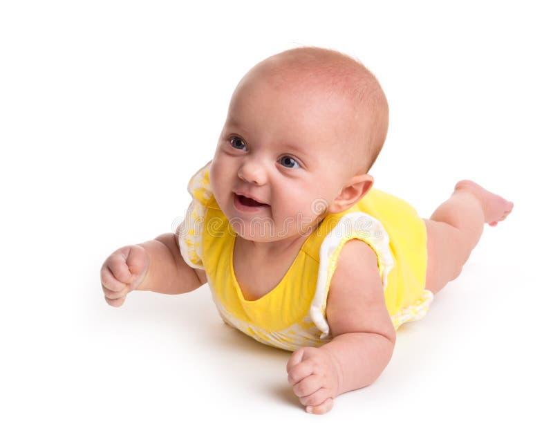 Bambino sorridente sveglio isolato su bianco fotografie stock libere da diritti