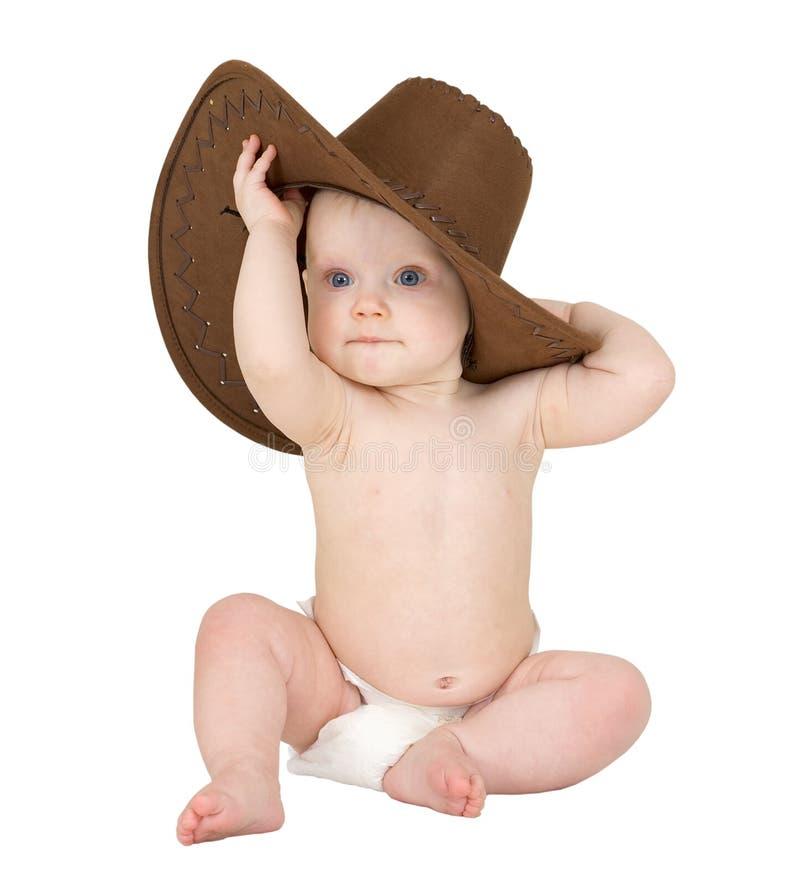 Bambino su una priorità bassa bianca con il cappello di cowboy fotografie stock